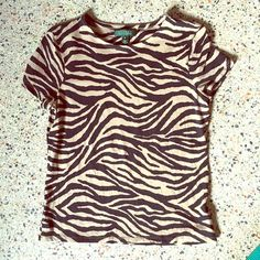 Ralph LaurenTiger Print Tee Adorable tiger print tee in cream and black. Show off your wild side! Tee is stretchy and gently used. Ralph Lauren Tops Tees - Short Sleeve