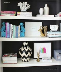 Book shelves are so interesting- I love the little mesh organizer, the chinese dragon bookends and all the animals :-)