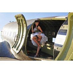 Sexy 1940s style pin-up girl standing inside of a C-47 Skytrain aircraft Canvas Art - Christian KiefferStocktrek Images (35 x 23)