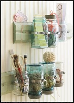 Like the balls of string upside down in jar, great  idea for garden shed.