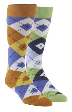 Statement Sockwear: Modified argyle sock design featuring orange, lime and blue variations. Every 2-pack gift box provides 200 days of clean water for someone in Africa. Make a statement. Make a difference.