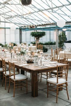 indoor garden wedding tables - photo by Brae Howard Photography http://ruffledblog.com/sophistication-and-elegance-at-horticulture-center #greenhouse #greenhousewedding