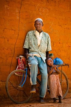 man and child with bike, somewhere in Africa