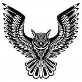Flying owl black silhouette with a pattern on the body.