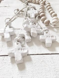 a beautiful white cross to hang on wall or to wear...handmade by CezWith a leather cordChoose what is written on: WILD