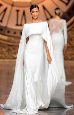 "Gorgeous Wedding Dresses with Striking Illusion Details ""Verona"" crepe dress with off-the-shoulder neckline and cape by Atelier Pronovias. Photography: Courtesy of Atelier Pronovias. Gorgeous Wedding Dress, White Wedding Dresses, Bridal Dresses, Beautiful Dresses, Wedding Gowns, Formal Dresses, Wedding Ceremony, Wedding White, Wedding Dress Cape"