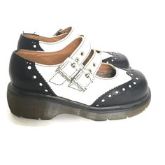 Vintage 90s Doc Marten Mary Janes in black and white. Made in England! Features dual adjustable straps with buckles. leather upper, welt construction