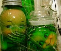 Take used doll parts, add some skeleton parts, fill jar with water and add green food coloring....great Halloween Decor