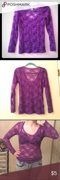 Purple Lace & Mesh Long Sleeved Top Very cute and sexy sheer see through floral purple lace and mesh top! Layer it over or under another top, or a bandeau bra. I modeled it with a normal bra sorry 🤓 Small hole on the bottom right side, not noticeable. Some of the elastic is fraying a bit, not too noticeable. Runs small! It is stretchy and does fit me (I wear mediums) but it is tight. Would fit a small or extra small person more comfortably I think. Bozzolo Tops Tees - Long Sleeve