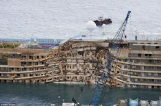 Destroyed: Work began to right the stricken Costa Concordia vessel, which sank in January 2012. If the operation is successful, it will then...