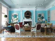 Beachy blue walls, white trim, lots of color = great living room!