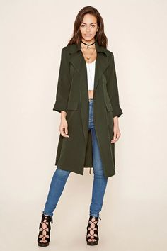 A woven trench jacket featuring a notched lapel with an open front, two front flap pockets, long sleeves, #thelatest