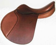 Jumping saddle: Looks a bit funny because the saddle flap is a bit more forward than usual. But, it is made for jumping!