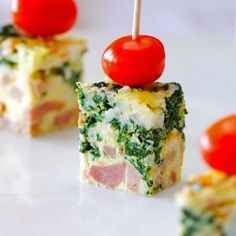 Cut a frittata into bite-sized squares and top with cherry tomatoes and a toothpick.  Awesome appetizer!