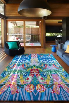 """We've teamed up with """"Kaftan Queen"""" Camilla - fashion designer to the likes of Oprah and Beyonce, to create a unique, eye-catching collection of rugs that translate her vivid textile patterns into must-have floor coverings. This design is called Island Song and it is hand tufted from 100% New Zealand Wool."""