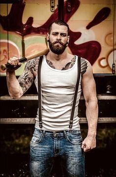 Beard. Ink. Wife-beater... I just need the braces!!