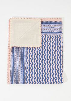 This hand-quilted blanket is not only beautiful but extremely soft and comfortable. The distinct wave-like pattern is made from hand-blocked layers...