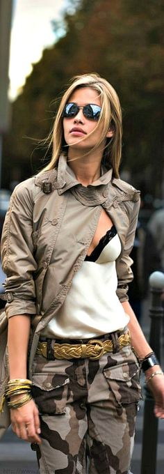 Street style: khaki trench, lingerie top, camo pants, gold accessories.