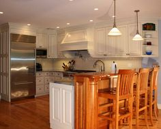 Pic of Kitchen Cabinets With Wooden Chair
