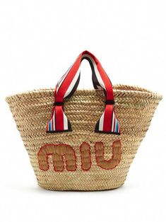 567bc2b1414 Miu Miu s woven basket bag is the perfect summer companion. It s  embroidered with the label s logo