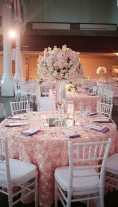 Blush satin rosette tablecloths Pink wedding reception decor with white chairs Pink centerpieces Quince Themes, Quince Decorations, Reception Decorations, Table Decorations, Quince Ideas, Pink Wedding Centerpieces, Quinceanera Centerpieces, Quince Centerpieces, Tall Centerpiece