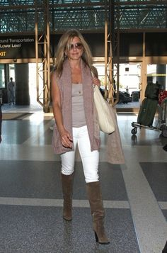 Jennifer Aniston wearing Ray-Ban 3025 Aviator Metal Sunglasses, Rolex Day Date Presidential Wristwatch with Champagne Stick Dial, Siwy Hannah Slim Ankle Jeans, SALVATORE FERRAGAMO SUEDE MIRRORED HEEL PULL ON BOOTS, Market Amber Tank,
