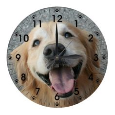 Smiling Golden Retriever Wall Clock! Let a happy golden retriever bring a smile to your face with this cheerful wall clock! Design features bold, easy-to-read numbers and black paw prints that mark each hour.