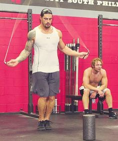 Roman Reigns and Dean Ambrose. Two of the best WWE wrestlers in the business today and great eye candy as well! Roman Reigns Workout, Wwe Roman Reigns, Raw Wrestling, Wrestling Superstars, Roman Reigns Dean Ambrose, Roman Regins, The Shield Wwe, Celebrity Workout, Raining Men