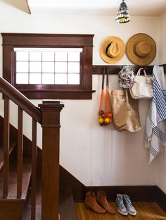 The handsome Arts and Crafts–style entry. And so it goes net bag on Lonny's cover story- Mia Maestro's home tour Dark Wood Trim, Decor, Home Diy, Staying Organized, Staircase Design, Interior, Wood Trim, Home Decor, House Interior