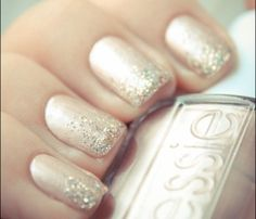Glam Glitter Nails: Fairy Pretty. Pick a metallic pinky-nude shade as a base coast then top it with silver glitter polish, creating a more opaque look at the tip of your nail. #SelfMagazine