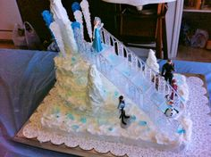 Here's the cake I made for my daughter's Frozen birthday. I ordered the figures & cake staircase (crystal, not white) online, then used rock candy (as seen on Pinterest) & upside down frosted ice cream cones with crushed rock candy sprinkled over top. It was a huge hit. I recommend not adding rock candy until last minute. I used rice krispy for the top layer, but even that had a hard time holding up to the heat of an outdoors party and the rock candy.