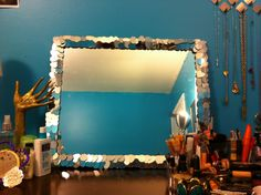 Make your mirror look more magical with cheap mini mirrors that you can get from the dollar store!