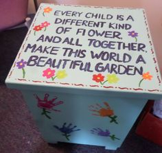 """A Bright Horizons center in Marshfield, WI created a """"Week of the Young Child"""" art auction project. The children helped paint the entire table. Each child's handprint was added, creating an individual flower for each child in the classroom. Finally, they added the phrase to express the diversity and uniqueness that makes up their classroom community and world. Parents had the opportunity to buy the table at their art auction."""