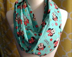 Usher in Springtime with this teal bird themed infinity scarf. 100% cotton. CARE: Machine wash in gentle cycle with cold water or Dry clean Air Dry or lay flat on a horizontal surface.