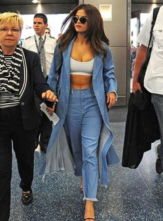 What makes this look especially cool is that she styled the jacket open over a barely-there white sports bra that showed off her toned (and bronzed) abs