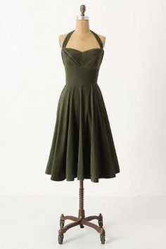 This hunter green halter dress from Anthropologie can be made strapless. $158