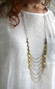 Pretty Withe Dress with a Gold Necklace