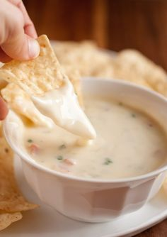 Queso Blanco Dip- Ingredients 2 Tbsp butter  1/4 cup finely chopped onion*  1/4 tsp crushed garlic*  2 Tbsp all-purpose flour  1 1/4 - 1 1/2 cups whole milk (for thicker sauce use lesser portion)  8 oz. finely shredded Monterey Jack cheese    Optional ingredients  1 Roma tomato, seeds removed then diced  2 Tbsp canned, diced green chilis  1 Tbsp chopped fresh cilantro