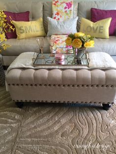 Summer Sofa! Keep the furniture neutral, so you can change out your accessories with the seasons.  Here, the quilt is the centerpiece and the pillows are there to accent it. Touches of vintage pink depression glass, a pink candle, and some lovely yellow faux flower arrangments to add to the cheer! All of these accessories are available at HomeGoods.