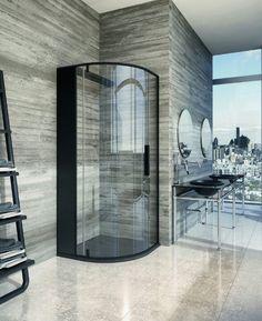glass shower in stone washroom