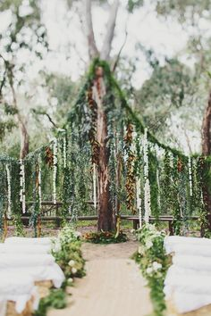 Luxe Bohemian Chic Wedding - Twilight-esque wedding backdrop with lots of greenery and white blossoms. Woodsy Wedding, Forest Wedding, Floral Wedding, Dream Wedding, Wedding Altars, Chic Wedding, Wedding Locations, Wedding Venues, Wedding Backdrops