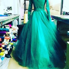 """Beautiful emerald cascading tulle gown being worked on in the studio today. #christiansiriano"""