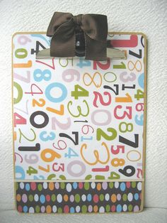 Cute clipboards using scrapbook paper! Have to make a soccer themed one for my kids soccer coach :)