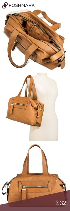 Congnac Duffle Bag This Women's Solid Cognac Duffle Weekender Handbag is perfectly sized for all your overnight must-haves. It features a neutral tan color, thick double shoulder handles, side buckle details, front zip pouch and hidden interior pockets. Black accents around the edges add dimension to this versatile bag. Faux Leather. A + Bags
