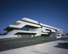 Recessed glass strips along the exterior wall enhances the dynamics of this futuristic building by Zaha Hadid.