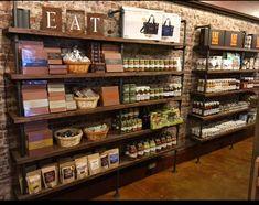 Entry of shop - Large Pipe shelving unit Bookcase Wall Shelves Coffee Shop Design, Cafe Design, House Design, Glass Shelves In Bathroom, Floating Glass Shelves, Bathroom Niche, Bookcase Wall, Wall Shelves, Retail Shelving
