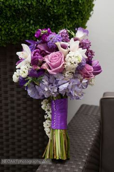 Purple bridal bouquet! Calla lilies, roses, and other assorted flowers in shades of lilac and lavender.