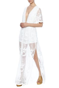 c828e3232f11 White lace romper with a maxi skirt and deep v-neckline. Embroidered Maxi  Romper