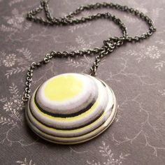 Lemon Sky Necklace with Layered Paper by TheSpacesInBetween, $28.00! But I am making me this in my art class!