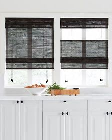 Window treatment ideas from Martha Stewart: Back blinds with a white kitchen are so surprising and striking.